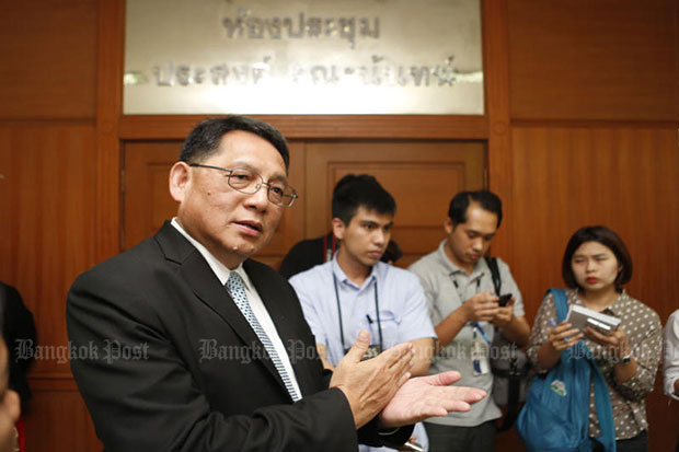 Permanent secretary for labour Jarin Jakkaphark talks to the press after a meeting on a minimum-wage increase at the Labour Ministry on Wednesday. (Photo by Pattarapong Chatpattarasill)