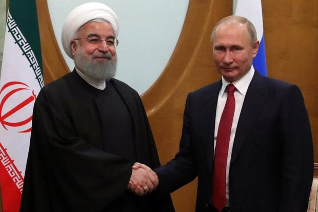 Russian President Vladimir Putin, right, shakes hands with Iranian President Hassan Rouhani during their bilateral meeting in Russia last November. (EPA photo)