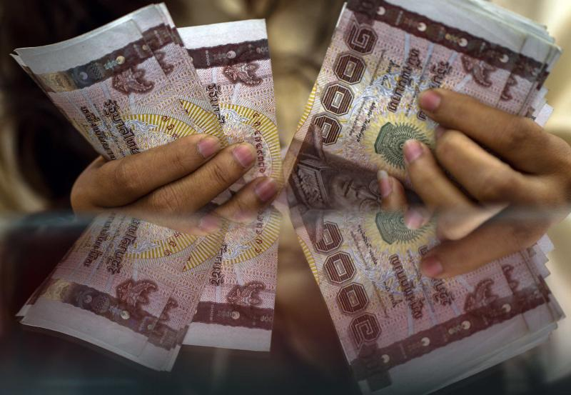The baht continues to rise against the US dollar. (Reuters photo)