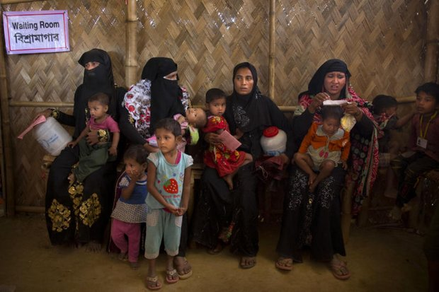 Rohingya Muslim refugee women and children wait at a nutrition centre to collect food at Balukhali refugee camp near Cox's Bazar, Bangladesh on Tuesday. (AP photo)