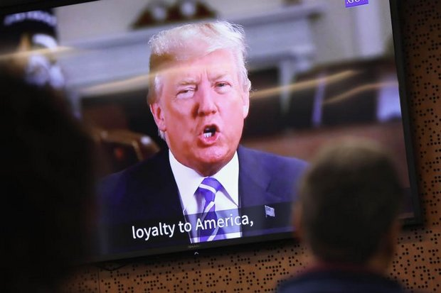 President Donald Trump addresses new US citizens via taped video shown at a naturalisation ceremony for immigrants from 32 different countries, held at Newark, New Jersey. (AFP photo)