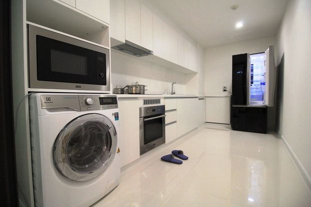 The renovated kitchen of a unit at Chani Residence on Sukhumvit 55. (Photo supplied by CBRE)