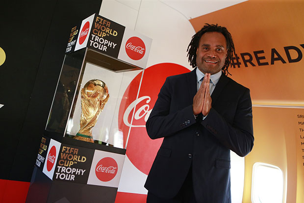 Former French national footballer Christian Karembeu offers a wai as he brings the 2018 Fifa World Cup trophy to Phuket on Friday.