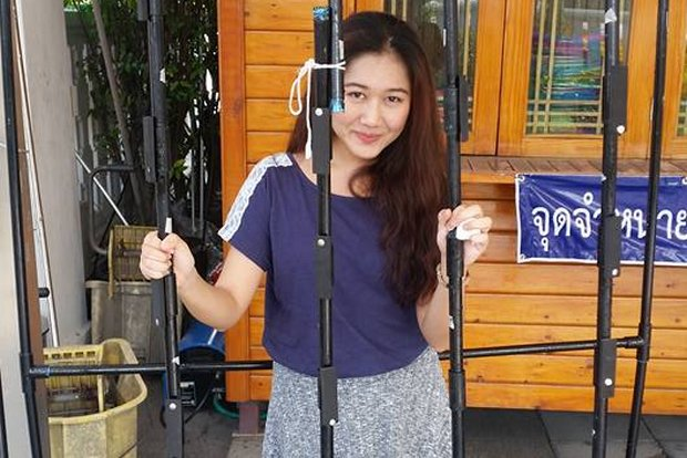 Chanoknan 'Cartoon' Ruamsap, seen here at home in Bangkok, says she had just 30 minutes to decide, then pack and flee ahead of a junta arrest order. (FB/Moo.Cartoon)