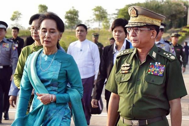 Elected civilian leader Aung San Suu Kyi (left, in blue) has been overshadowed by the army, led by Snr Gen Min Aung Hlaing. Her adviser say flatly that 'the army doesn't want peace' with the Rohingya or other ethnic groups. (File photo)