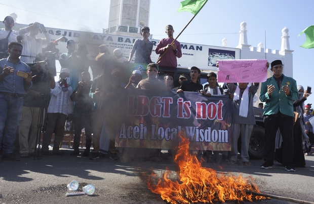 Muslim protesters pray as they burn an effigy during an anti-LGBT rally in Banda Aceh on Friday. (AP Photo)