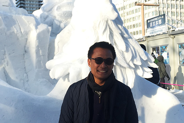 TAT's Kitsana Kaewtumrong poses with an ice sculpture. A Thai team will compete in an ice-sculpting competition in Japan.