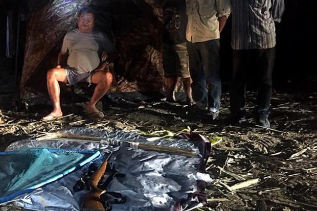 Italian-Thai Development president Premchai Karnasuta (seated) was photographed by park wardens with three companions, guns and animal remains when he was confronted by the chief of Thungyai Naresuan park on Sunday night.