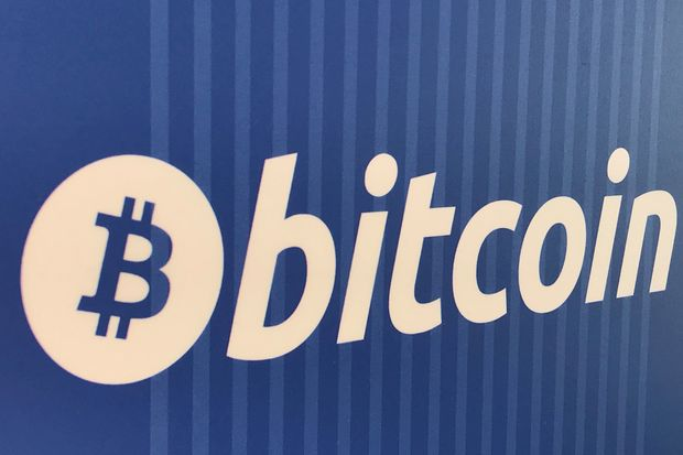 A Bitcoin logo is seen on a cryptocurrency ATM in Santa Monica, California, on Jan 4. (Reuters photo)