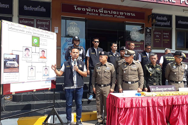 A policeman uses a chart to explain to the media a crackdown on a drug network in Muang district in Ubon Ratchathani during a briefing on Sunday. (Photo by Nila Singkiree)
