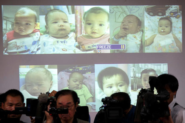 Surrogate babies that Thai police suspect were fathered by a Japanese businessman who then fled from Thailand are shown on a screen during a news conference at the headquarters of the Royal Thai Police in Bangkok August 12, 2014. (Reuters file photo)