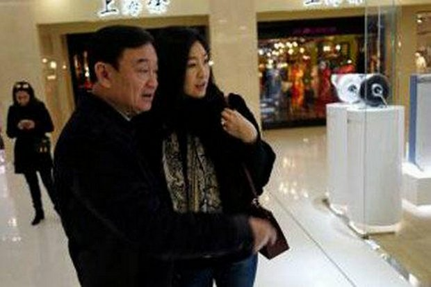 Fugitive ex-prime ministers Thaksin (left) and younger sister Yingluck Shinawatra, spotted recently in Japan in this photo spread on social media, were seen Tuesday in Singapore.