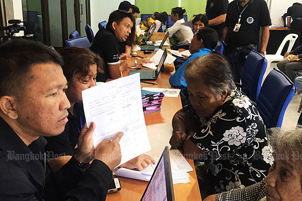 Locals who claim to have received welfare payments below the amounts recorded by state officials explain to members of the Public Sector Anti-Corruption Commission why they signed receipts showing the full payment of 3,000 baht each.Supapong Chaolan