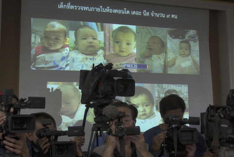 In this Aug 12, 2014, file photo, the media attend a press briefing where Thai police display projected pictures of surrogate babies born to a Japanese man at the centre of a surrogacy scandal during a press conference at the police headquarters in Chonburi, Thailand. (AP file photo)