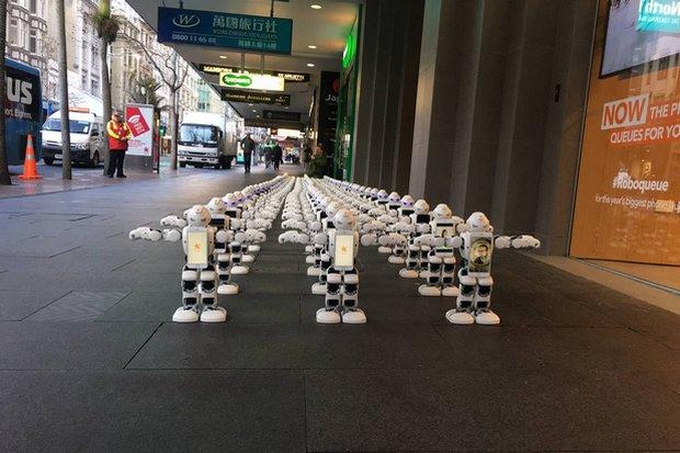 UBTECH Robotics' 'cute' robots queue for customers at a recent iPhone launch in Auckland, New Zealand. (Creative Commons, Pinterest.com)