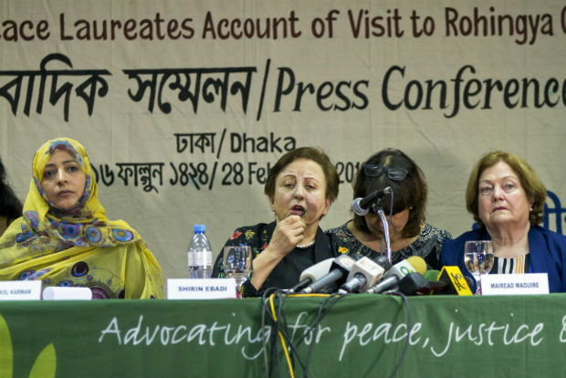 Nobel Peace laureates, from left, Yemen's Tawakkol Karman, Iran's Shirin Ebadi and Ireland's Mairead Maguire address a press conference after their visit to the Rohingya refugee camps in Dhaka, Bangladesh, on Wednesday,  (AP Photo)