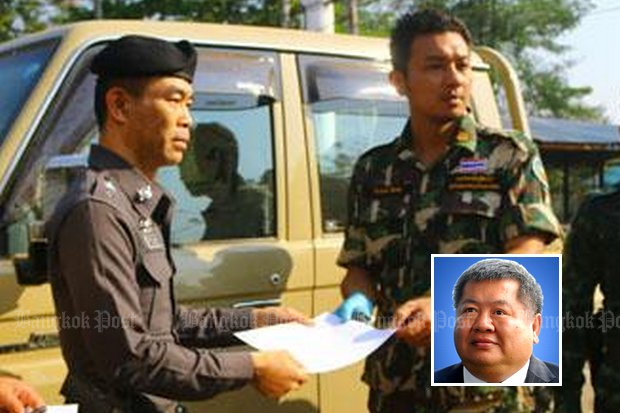 Pol Col Wuthipong Yenjit of the Thong Pha Phun police station is seen accepting the impounded Toyota Land Cruiser used by construction tycoon and accused poacher Premchai Karnasuta (inset) on Feb 13. Pol Col Wuthipong has punished a police captain for accepting charges of cruelty to animals against the Italian-Thai Development chief executive. (File photo by Piyarach Chongcharoen)