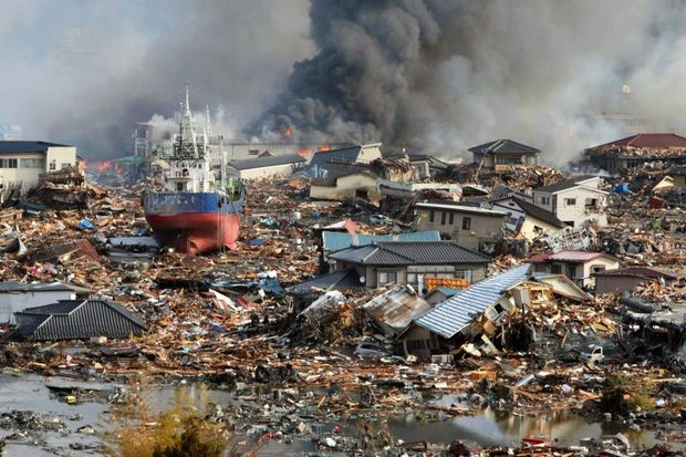 Flashback: The seventh anniversary of the great tsunami and nuclear accident on Sunday realls the burning houses and ships piled amidst tsunami floodwater seen in Kisenuma city in 2011. The tsunami devastated northeastern Japan and triggered a nuclear disaster at the Fukushima Daiichi Nuclear Power Plant. (EPA photo)