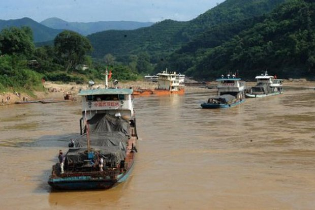 File photo from February, 2015, shows large cargo ships that have run aground in the Mekong off Chiang Rai province.