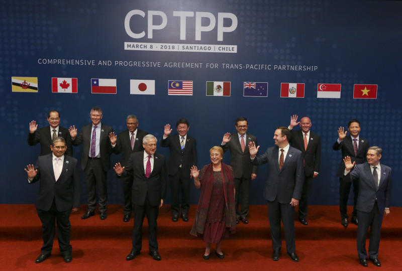 Ministers of the Comprehensive and Progressive Agreement for Trans-Pacific Partnership pose for an official photo prior the signing ceremony in Santiago, Chile, on Thursday. (AP photo)