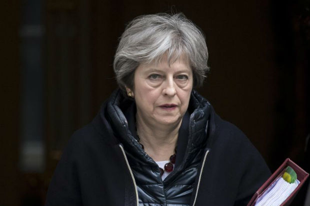 Britain's Prime Minister Theresa May leaves No. 10 Downing Street to attend the Prime Minister's Questions in the Houses of Commons, in London, on Wednesday. (EPA photo)
