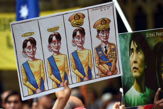 Posters referring to Myanmar's State Counselor Aung San Suu Kyi are displayed at a protest during the Asean (Association of Southeast Asian Nations)-Australia Special Summit in Sydney on Saturday. (AFP photo)