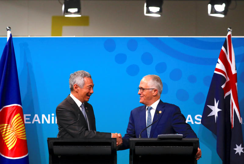 Australian Prime Minister Malcolm Turnbull (right) shakes hands with Prime Minister of Singapore Lee Hsien Loong during their media conference during the one-off summit in Sydney on Sunday. (Reuters photo)