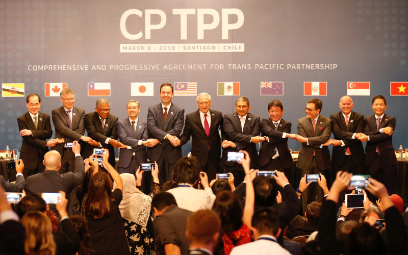 Representatives of member countries of the Trans-Pacific Partnership trade pact pose for an official picture after the signing ceremony in Santiago on March 8, 2018. (Reuters photo)