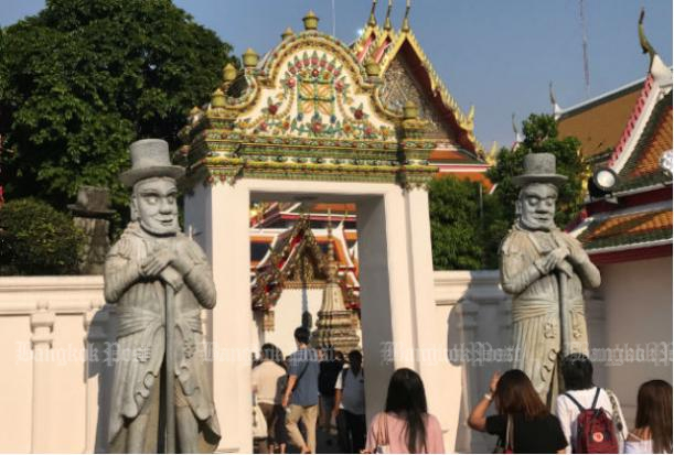 Tourists visit Wat Phra Chetuphon (Wat Pho) in Bangkok on March 2, 2018. (Photo by Dave Kendall)