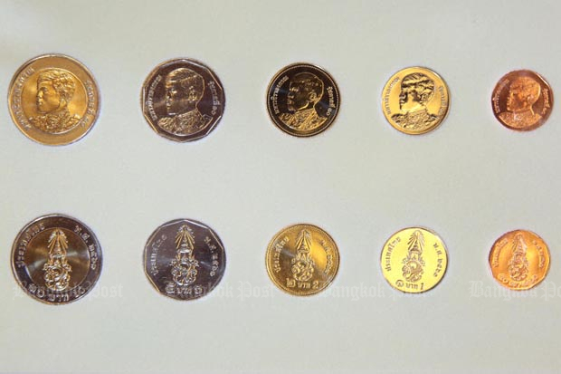 New coins featuring King Rama X will go into circulation on April 6. Samples from left: 10, 5, 2 and 1 baht and 50 satang. (Photo by Wichan Charoenkiatpakul)