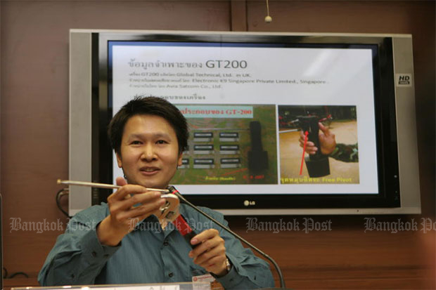 Jetsada Denduangboripan, a science lecturer at Chulalongkorn University, slams the effectiveness of the GT200 bomb detector, describing it as similar to a wooden rod people used to detect dead bodies buried in a cemetery. He shows a similar device he built that could function as well as the GT200 - and cost only 350 baht. (Bangkok Post file photo)