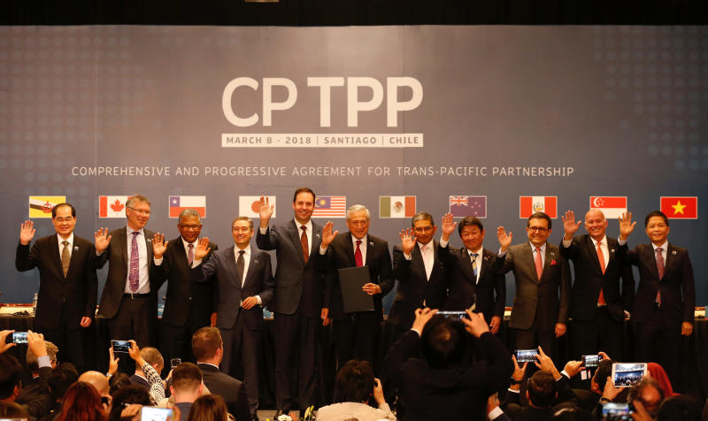 Representatives of members of the Comprehensive and Progressive Agreement for Trans-Pacific Partnership trade deal pose for an official picture after the signing agreement ceremony in Santiago, Chile, on March 8, 2018. (Reuters photo)