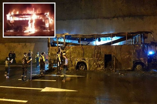 The burnt-out bus sits at the side of the road after firemen extinguished the fire. (Photos by Assawin Pinitwong)