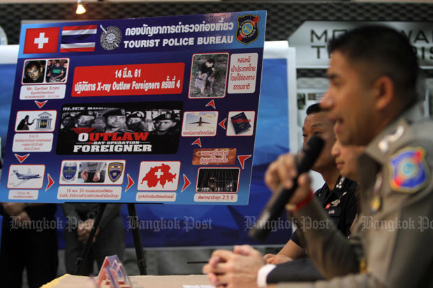 Pol Maj Gen Surachet Hakpal, deputy commissioner of tourist police, holds a press conference on the arrest at the Immigration Bureau in Bangkok Friday. (Photo by Apichart Jinakul)