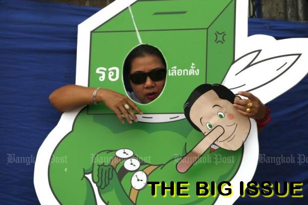 Figure of fun: A pro-democracy demonstrator holds a mask of Thai Prime Minister Prayut Chan-o-cha with a Pinocchio nose. (File photo)