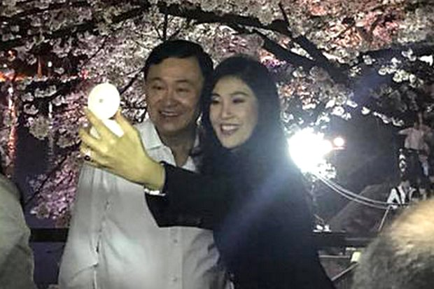 Thaksin and fellow fugitive sister Yingluck Shinawatra take a selfie as they enjoy the cherry blossoms in Japan, their second tour of the region in a month. (FB/IngShinawatra)