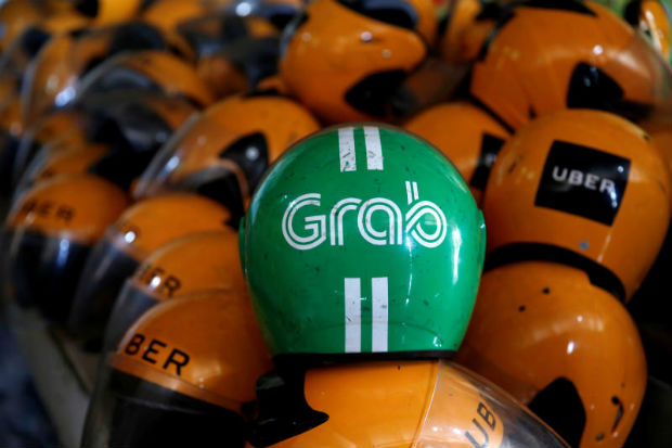 Used Grab and Uber helmets are seen at used-helmet shop in Jakarta, Indonesia, on Tuesday. (Reuters photo)