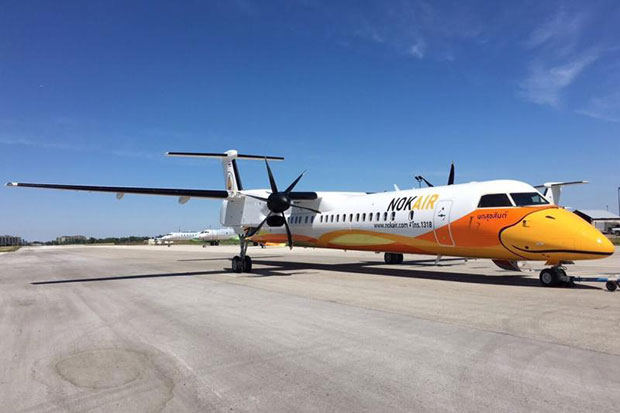 A NokAir Bombardier Q400 twin jet prop like the one that developed a fault at Buriram airport. (Nok Air photo)