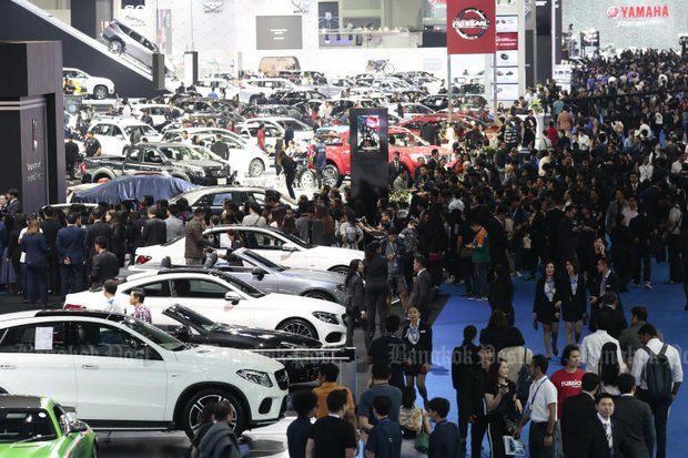 Car purchases, especially at exhibitions like the Bangkok International Motor Show 2018 (above) are a key factor behind rising household debt. (Photo by Patipat Janthong)