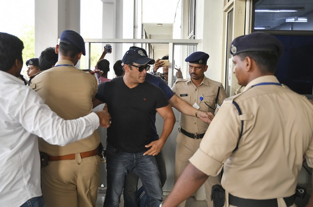 Salman Khan arrives at the airport in Jodhpur after being freed on bail on Saturday as he prepares to appeal his conviction on poaching charges. (AP Photo)