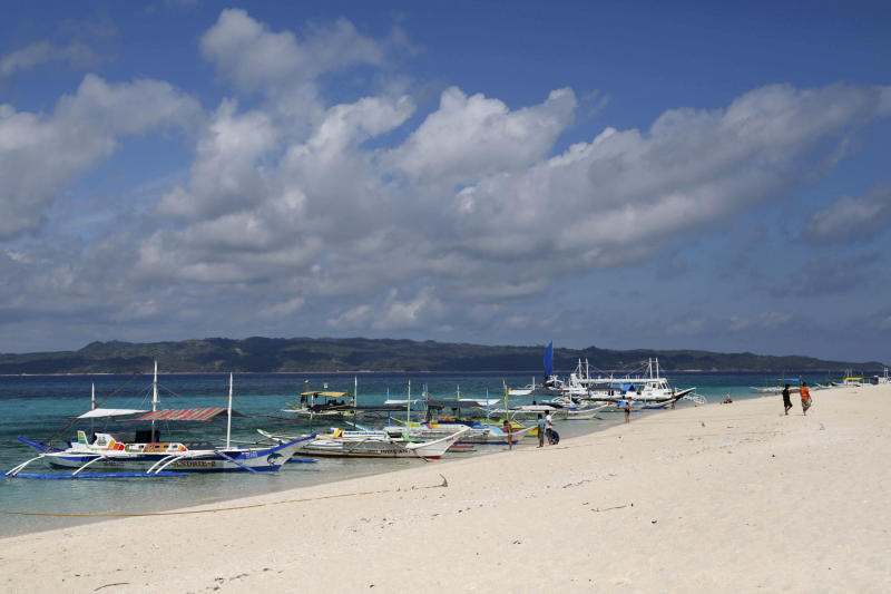 Traditional boats line up the shore in a secluded beach on the island of Boracay, central Philippines. (Reuters file photo)