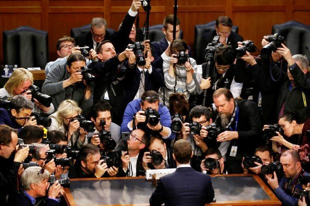 Photographers pushed towards the witness table to get a photo of Facebook chief Mark Zuckerberg before he began testimony at the US Congress on Tuesday. (Reuters photo)