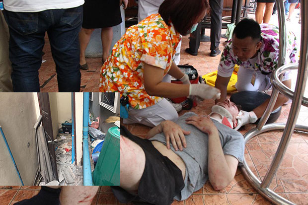 Rescue volunteers give first aid to a Finnish man injured after falling from the fourth floor of a small hotel in Pattaya, Chon Buri on Wednesday. (Photo by Chaiyot Pupattanapong)