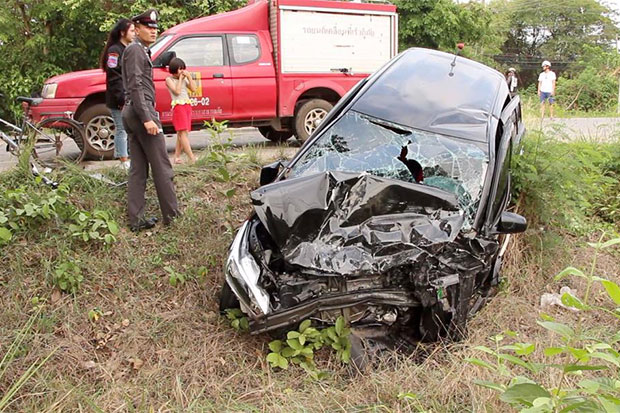 A car plunged into a roadside ditch following a crash with a pickup truck in Muang district of northeastern Kalasin province, killing a 65-year-old woman and injuring 11. (Photo by Yongyut Phupuangphet)