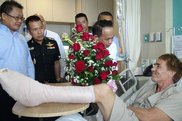 Senior officials visit Werner Danielsen, a Norwegian tourist, who sustained injuries while swimming off a beach in Hua Hin, Prachuap Khiri Khan. Authorities have yet to conclude whether he was bitten by a shark. (Photo by Chaiwat Satyaem)