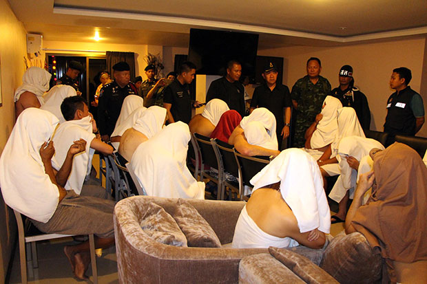 Party goers are rounded up by security authorities on Saturday night at a hotel where they attended a swingers' party. (Photo by Chaiyot Pupattanapong)