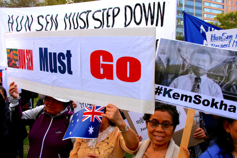 File photo: Protesters hold placards and banners during a demonstration against Cambodia's Prime Minister Hun Sen, in Sydney, Australia March 16, 2018. (Reuters photo)