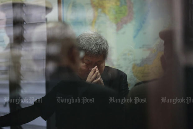 Italian-Thai Development president Premchai Karnasuta reacts after an interrogation by Natural Resources and Environmental Crime Suppression Division police on March 21, 2018. (Photo by Patipat Janthong)