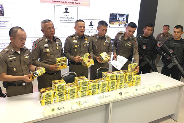 A total of 30kg of crystal methamphetamine, worth about 30 million baht, seized from the two drug suspects in Bangkok on Tuesday is shown at a media briefing on Wednesday. (Photo by Sutthiwit Chayutworakan)