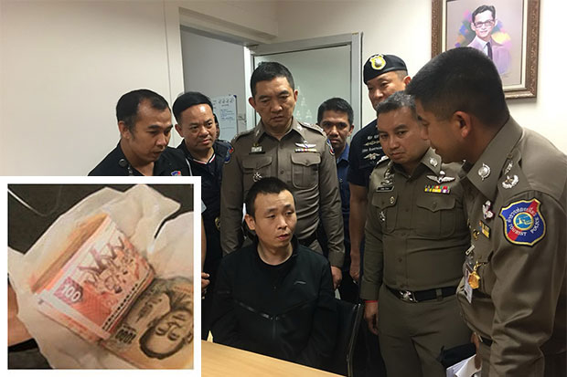 Chinese national Xu Xueliang, 32, is interrogated over the in-flight theft of cash from another passenger after being arrested at Suvarnabhumi airport on arrival from Hong Kong on Wednesday evening. Cabin crew said he was found holding the money, wrapped in tissue paper (inset), in his right hand. (Photo by Sutthiwit Chayutworakan)